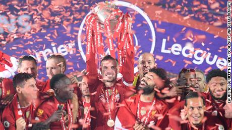 Jordan Henderson lifts the Premier League trophy after Liverpool's victory over Chelsea.