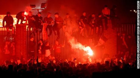 Liverpool fans celebrate outside Anfield stadium during the Premier League trophy presentation.