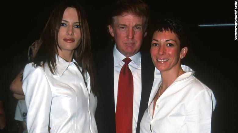 From left, Melania Knauss (later Melania Trump), Donald Trump and Ghislaine Maxwell pose together during the Anand Jon Fashion Show, New York, September 2000.