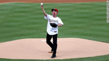 Dr. Anthony Fauci, director of the National Institute of Allergy and Infectious Diseases throws out the ceremonial first pitch prior to the game between the New York Yankees and the Washington Nationals at Nationals Park on July 23, 2020 in Washington, DC.