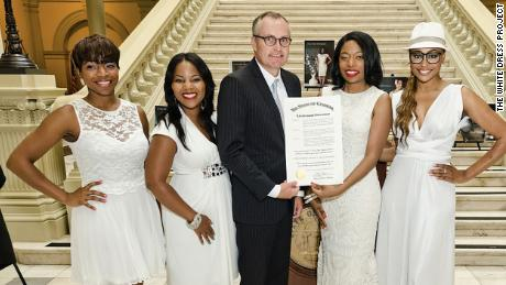 Tanika Gray receiving the Georgia resolution in 2014 declaring July Fibroid Awareness Month.