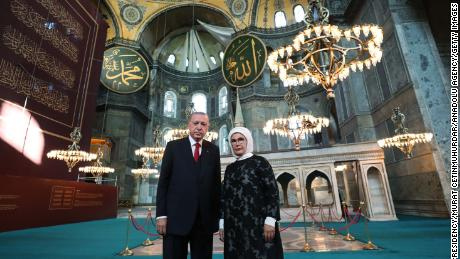 Turkish President Recep Tayyip Erdogan poses for a photo with his wife Emine Erdogan during a visit to inspect the Hagia Sophia mosque on the eve of its reopening to worship.