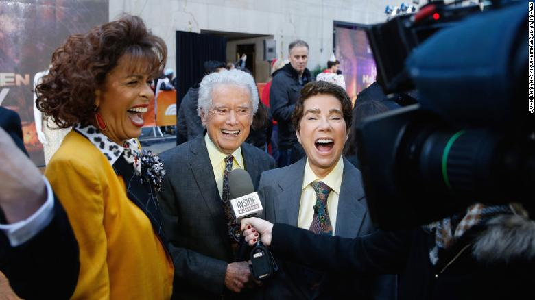 "Hoda Kotbe, at left dressed as Kathie Lee Gifford, Regis Philbin, and Kathie Lee Gifford dressed as Philbin, attend NBC's ""Today"" show at Rockefeller Plaza  in New York City on October 31, 2016."