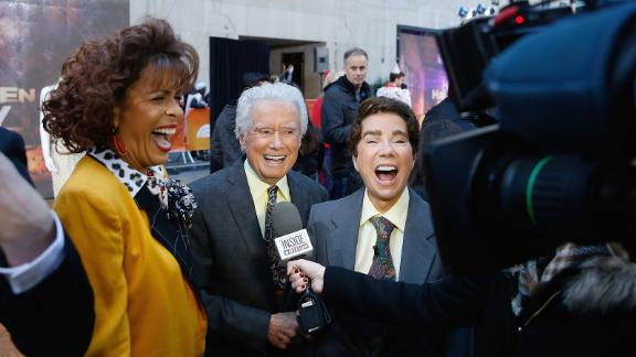 """Hoda Kotbe, at left dressed as Kathie Lee Gifford, Regis Philbin, and Kathie Lee Gifford dressed as Philbin, attend NBC's """"Today"""" show at Rockefeller Plaza  in New York City on October 31, 2016."""