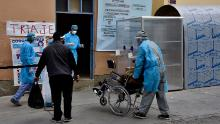 Health workers bring a suspected coronavirus patient into a hospital in La Paz on July 23, 2020.