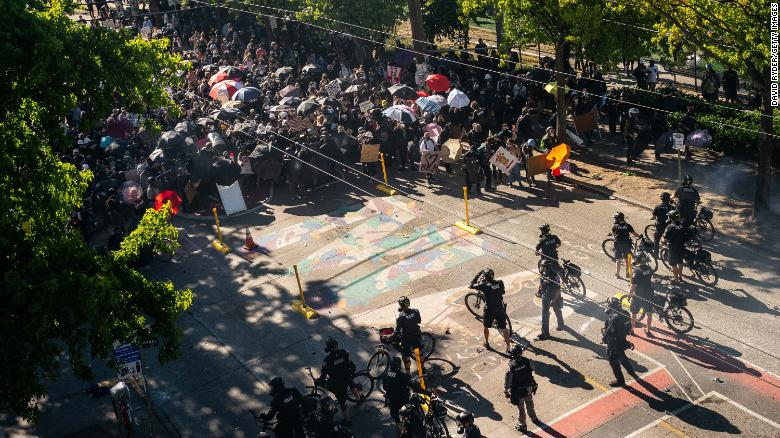 Police push demonstrators back atop a Black Lives Matter street mural in the area formerly known as CHOP during protests in Seattle on July 25, 2020 in Seattle, Washington.