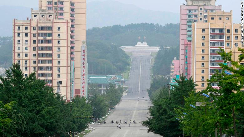 People make their way in the North Korean city of Kaesong in this file photograph from July 23, 2019.