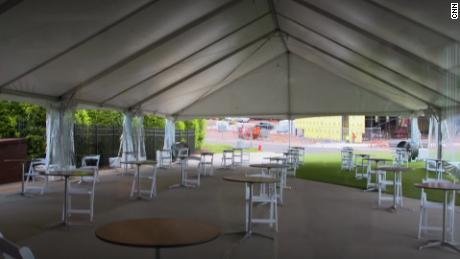 Players at the practice facility will dine alone at spaced tables.