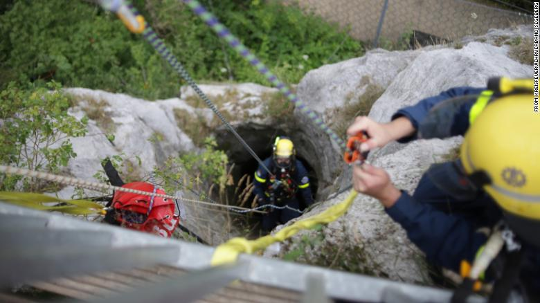The rescuer wore breathing apparatus to go down the 130-foot well.