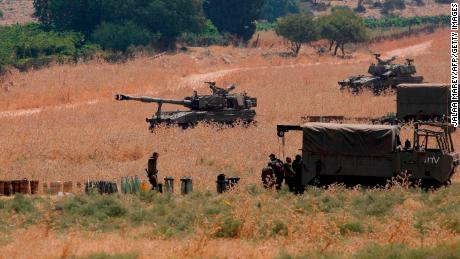 Armoured vehicles and 155 mm self-propelled howitzers are deployed in the Upper Galilee in northern Israel on the border with Lebanon on July 27, 2020.