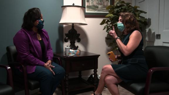 A screenshot of CNN's Elizabeth Cohen interviewing the first US participant to receive Moderna's Phase 3 trial vaccine.