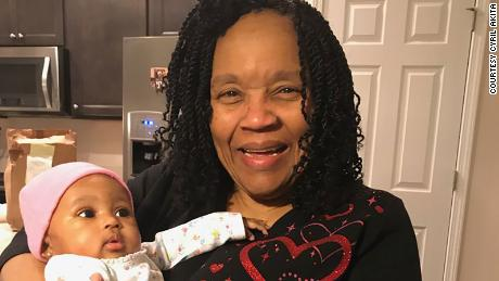 Dr. Antoinette Akita with her granddaughter.