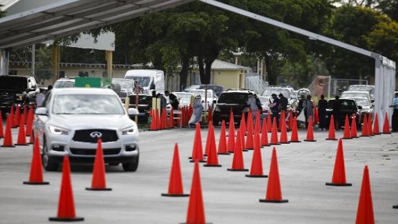 A line forms at a self-swab Covid-19 drive-thru testing site in Miami on Monday.