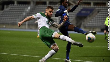 Saint-Etienne defender Mathieu Debuchy (left) fights for the ball with Paris FC's Jonathan Pitroipa in a French Cup match earlier this year.