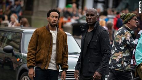 """(From left) Ludacris as Tej Parker and Tyrese Gibson as Roman Pearce are shown in a scene from """"F9."""""""