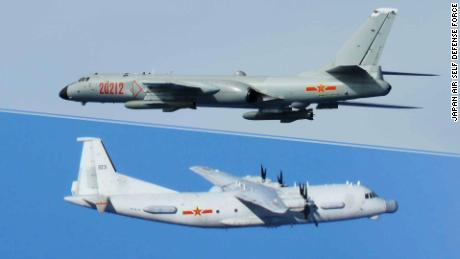 A Chinese H-6 bomber and Y-9 transport aircraft photographed by Japanese fighters on intercept missions.