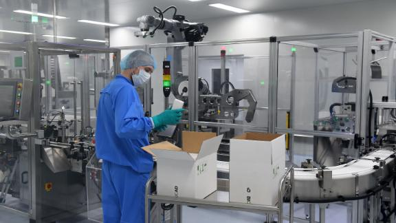 An employee wearing protective equipment works at the production line of Russia's biotech company BIOCAD, which is developing its own vaccine against the new coronavirus and working on another one in cooperation with the country's virus research centre in Siberia, Vektor, in Strelna on May 20, 2020. (Photo by OLGA MALTSEVA / AFP) (Photo by OLGA MALTSEVA/AFP via Getty Images)