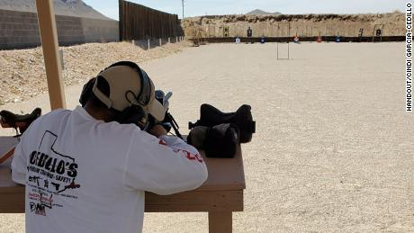 Rafael Cedillo, owner and instructor of Cedillo's Firearm Traning Safety & More, demonstrates the use of a firearm during a safety course at Ysleta Tactical Ranch in El Paso, Texas.