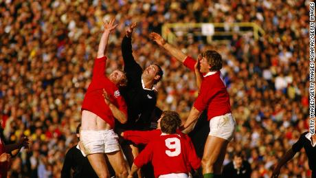 Andy Haden (center) reaches for the ball during a test between New Zealand and the Lions in 1983.