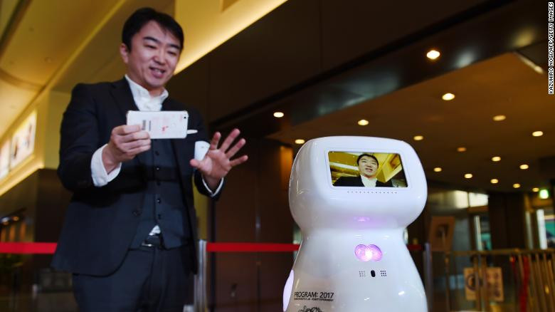 Donut Robotics CEO Taisuke Ono tests out the communication robot prototype, Cinnamon, at Tokyo's Haneda Airport in 2017.