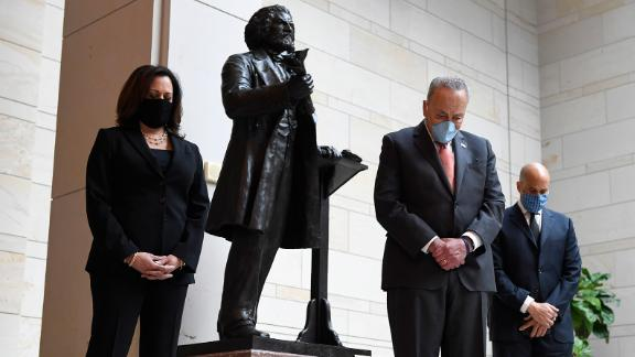 From left, Harris, Senate Minority Leader Chuck Schumer and US Sen. Cory Booker stand near a Capitol Hill statue of abolitionist Frederick Douglass during a June 2020 event commemorating the life of George Floyd. Floyd, an unarmed Black man, was killed in police custody in Minneapolis.