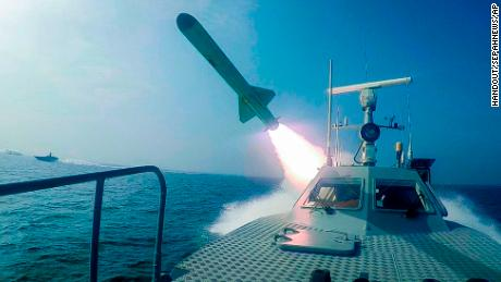 In this photo, released by Sepahnews on Tuesday, a revolutionary guard speedboat fires a rocket during a military exercise.