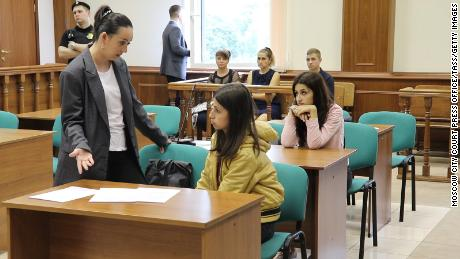 Angelina (center) and Krestina (back), during a hearing at Moscow's Basmanny District Court.