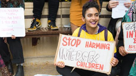 Intersex activist Pidgeon Pagonis protests outside the hospital in 2017.