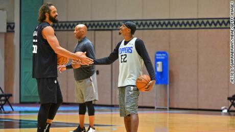 Joakim Noah #55 and Lou Williams #23 of the LA Clippers shake hands during practice as part of the NBA restart 2020 on July 21, 2020 in Orlando, Florida.