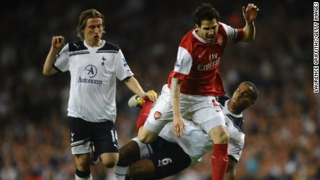 Playing for Arsenal, Fabregas is tackled by Tom Huddlestone of Spurs during the Premier League match between Tottenham Hotspur and Arsenal at White Hart Lane on April 20, 2011 in London, England.