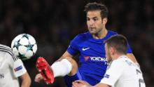 Fabregas (L) vies with Qarabag's Azerbaijani midfielder Gara Garayev during the UEFA Champions League Group C football match between Chelsea and Qarabag at Stamford Bridge in London on September 12, 2017.