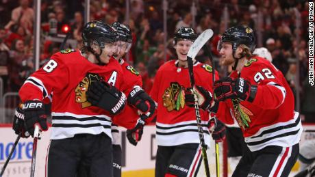 Patrick Kane of the Chicago Blackhawks (L) celebrates with (L-R) Slater Koekkoek, Olli Maatta and Alex Nylander at the United Center on March 11, 2020 in Chicago, Illinois.