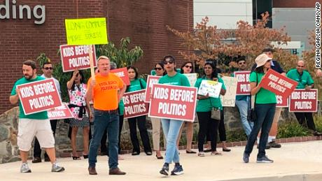 Protesters stand outside Howard County government building in Ellicott City, Maryland on September 26, 2019. The group is opposed to a school redistricting plan that will force some students to be relocated to other schools. (Regina Garcia Cano/AP)