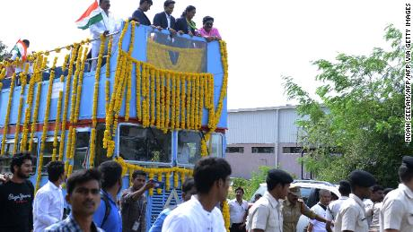 Swelling with pride: Sindhu (2R) is given a hero's welcome in Hyderabad with people lining the streets from the Aiport to the Gopichand Badminton Academy