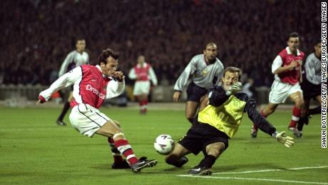 Francesc Arnau blocks a shot by Arsenal's Freddie Ljungberg during the 1999-2000 Champions League.