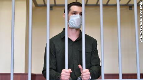 Trevor Reed stands inside a defendants' cage during his verdict hearing at Moscow's Golovinsky district court on July 30, 2020.