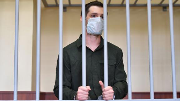 Former Marine Trevor Reed listens from inside a cage during his verdict hearing at Moscow's Golovinsky district court on July 30, 2020.