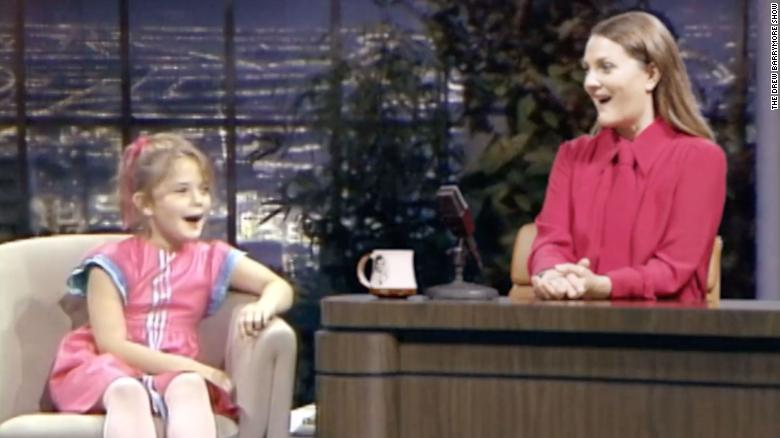 Drew Barrymore interviews her younger self as part of a promo for the Drew Barrymore Show