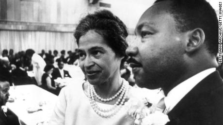Dr. Martin Luther King Jr. with Rosa Parks at dinner given in her honor during the Southern Christian Leadership Conference.