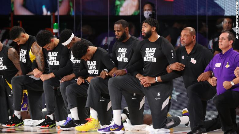 Los Angeles Lakers players kneeled during the national anthem before the game against the LA Clippers.