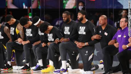 Nba Resumes Jazz And Pelicans Players Took A Knee Before Kicking Off The League S Reopened Season Cnn