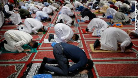 British Muslims are socially distanced as they gather to pray at the Minhaj-ul-Quran Mosque, at the start of Eid al-Adha, in London on Friday, July 31, 2020.