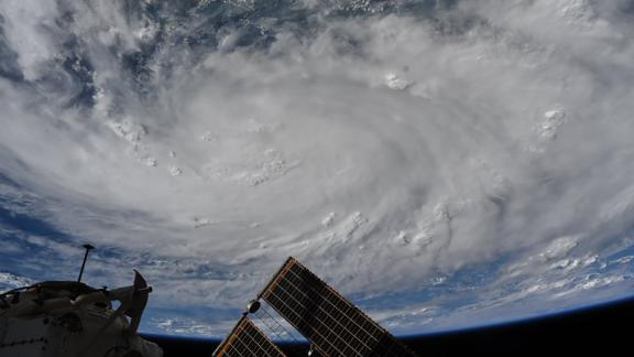"""Behnken took this photo of Hurricane Hanna on July 26: """"Snapped this photo of the storm in the Gulf of Mexico on Friday as it was starting to have observable structure from @Space_Station."""""""