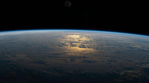 The sun's glint beams off a partly cloudy South Pacific as the International Space Station's orbital track took it halfway between Australia and South America on July 18.
