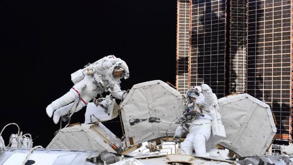 """Hurley <a href=""""https://twitter.com/Astro_Doug/status/1285676609312301056"""" target=""""_blank"""" target=""""_blank"""">tweeted this photo</a> of Behnken and Chris Cassidy on a spacewalk outside the International Space Station on July 21."""