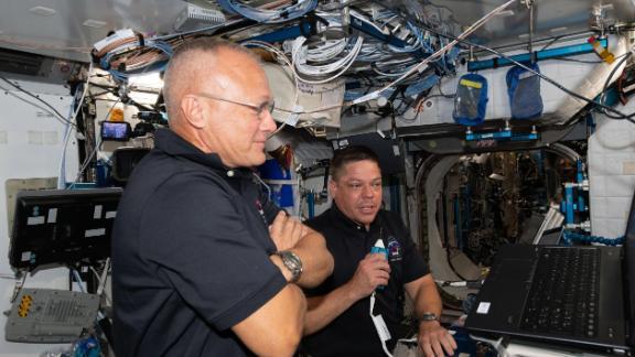 Hurley, left, and Behnken brief mission control on June 1.