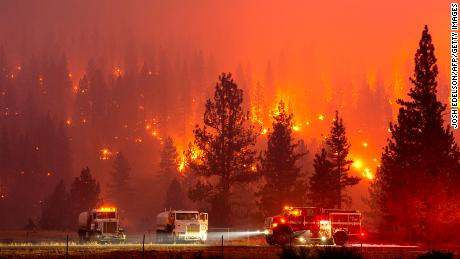 Firefighters brace for raging flames and growing pandemic