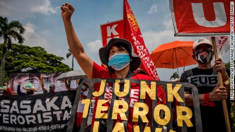 Protesters wearing facemasks take part in a protest against President Duterte on July 27 in Quezon city, Metro Manila, Philippines.