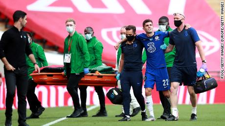Pulisic was helped off injured at the start of the second half.
