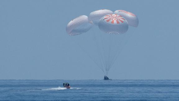 The SpaceX Crew Dragon Endeavour spacecraft is seen as it lands with NASA astronauts Robert Behnken and Douglas Hurley onboard in the Gulf of Mexico off the coast of Pensacola, Florida, Sunday, Aug. 2, 2020. The Demo-2 test flight for NASA